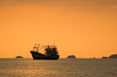 Seascape with fishing boat at sunset, Lipe island, Stock Photography
