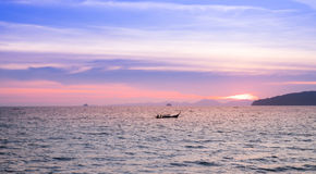 Seascape and fishing boats on the beautiful sea , sunset and violet sky Royalty Free Stock Photo