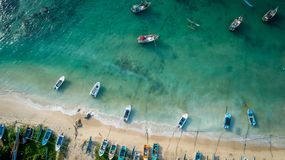 Seascape with fishing boats in the coast. Aerial view of beautiful seascape with fishing boats in the coast royalty free stock photo