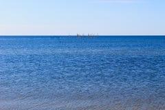 Seascape with fishing nets on horison. Seascape with fishing nets on a horison Royalty Free Stock Image