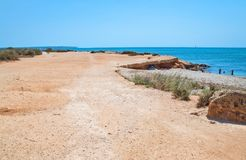 Seascape with flat ground and bike. On a sunny summer day in Mallorca, Spain Stock Images