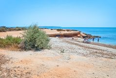 Seascape with flat ground and bike. On a sunny summer day in Mallorca, Spain Stock Photography