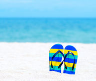 Flip flops on tropical beach Royalty Free Stock Photo