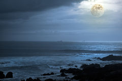 Seascape in a full moon night Stock Photo