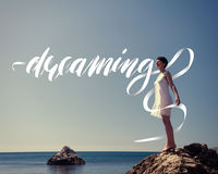 Seascape with a girl and word dreaming Stock Photos