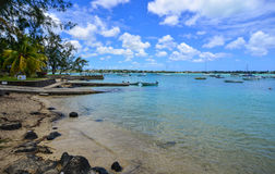Seascape in Grand Baie, Mauritius. Grand Baie, Mauritius - Jan 10, 2017. View of the small jetty in Grand Baie, Mauritius. Mauritius is a major tourist Royalty Free Stock Images