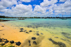 Seascape in Grand Baie, Mauritius. View of the beach in Grand Baie, Mauritius. Mauritius enjoys a tropical climate with clear warm sea waters, beaches Stock Photo