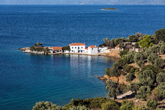 Seascape in Greece. Typical mediterranean landscape with white houses, olive trees and blue sea in Pagasetic Gulf in Thessaly, Greece Stock Photo