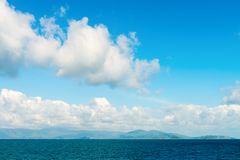 Seascape with green islands on horizon Royalty Free Stock Image