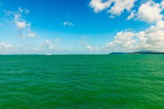 Seascape with green islands on horizon Royalty Free Stock Images