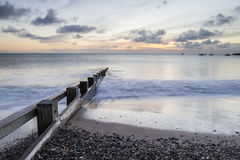 Seascape with groin and stones in Swanage bay Stock Photos