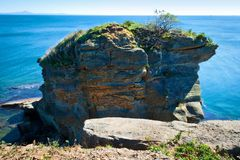 A rock by the sea. Horizontal photo with a view of the seascape Royalty Free Stock Photography