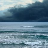 Seascape image with dark storm clouds and waves Royalty Free Stock Photography