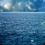 Waves on sea and cloudy sky. Seascape image of windy weather and waves on sea over cloudy sky Royalty Free Stock Photography