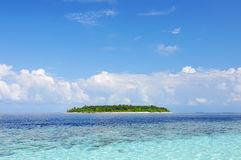 Seascape with island. Seascape and deserted island with copy space. Maldives, Indian Ocean Royalty Free Stock Images