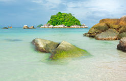 Seascape with island. Beautiful seascape with island, rock and a boat Royalty Free Stock Images