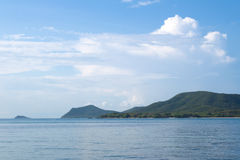 Seascape with island and blue sky. Samae San island, Thailand.  Stock Photos