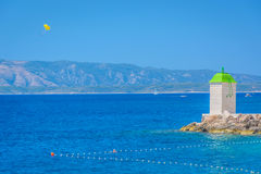 Seascape Island of Brac. Daylight view at lighthouse in town Bol on Island of Brac and Adriatic sea in Croatia, summertime Stock Photography