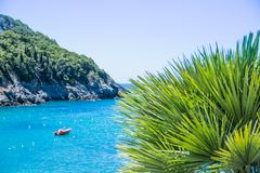 Amazing landscape azure bay in Paleokastritsa in Corfu island, Greece.summer landscape with mountains sea blue sky, sun royalty free stock images