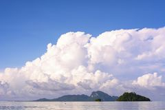 Seascape and island. Summer seascape ,blue sea ,green island with blue sky and big cloud background,Thailand Stock Images
