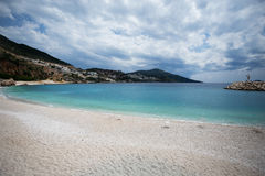 Seascape of Kalkan resort town of Turkey. Municipal beach of Kalkan resort town of Turkey located on Mediterranean sea with turquoise sea mountains and Stock Photography