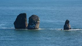 Seascape of Kamchatka Peninsula: Three Brothers Rocks in Avachinskaya Bay Pacific Ocean stock footage