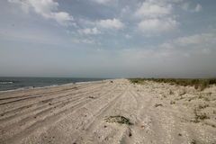 Seascape lös strand, havvågor Arkivfoto
