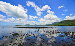 Seascape in Le Morne, Mauritius. Reflected sea with rocks Royalty Free Stock Images