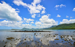 Seascape in Le Morne, Mauritius. Rocks on the beach under blue sky Stock Photo