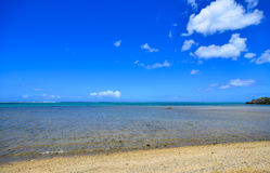 Seascape in Le Morne, Mauritius. Sand beach with blue sea under clear sky Royalty Free Stock Photos