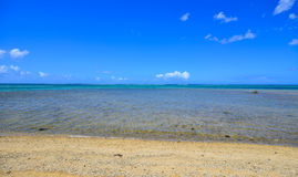 Seascape in Le Morne, Mauritius. Sand beach with blue sea under clear sky Stock Photo