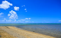 Seascape in Le Morne, Mauritius. Sand beach with blue water under clear sky Royalty Free Stock Photos