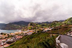 Seascape leading line to some city in Madeira and coastline royalty free stock photo