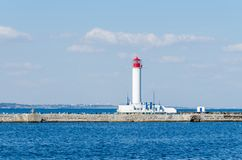 Seascape with lighthouse in the Odesa port. Lighthouse is placed in port of Odessa Stock Photography