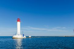 Seascape with lighthouse in the Odesa port. Lighthouse is placed in port of Odessa Royalty Free Stock Photography