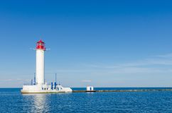Seascape with lighthouse in the Odesa port. Lighthouse is placed in port of Odessa Royalty Free Stock Image