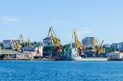 Seascape with lighthouse in the Odesa port. Lighthouse is placed in port of Odessa Royalty Free Stock Photo