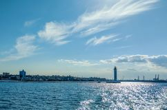 Seascape with lighthouse in the Odesa port. Lighthouse is placed in port of Odessa Stock Photos