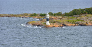 Seascape with lighthouse on rocks Royalty Free Stock Images