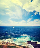 Seascape with Lighthouse and Sailing Yacht Royalty Free Stock Images