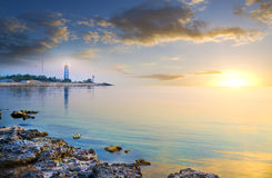 Seascape and lighthouse on the shore. Royalty Free Stock Photography