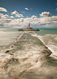 Seascape with a Lighthouse. Vertical Composition. Seascape with a lighthouse on the background taken a beautiful sunny day Royalty Free Stock Images