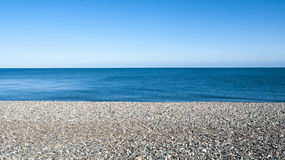 Seascape in Llandudno Wales UK. Seascape with pebble stone beach on a beautiful day in Llandudno Wales UK Stock Images