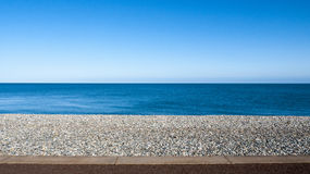 Seascape in Llandudno Wales UK. Seascape with pebble stone beach and sea defence wall on a beautiful day in Llandudno Wales UK Stock Photo