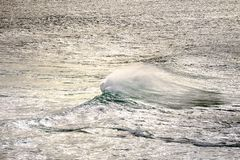 Seascape with lonely wave. And beautiful light royalty free stock image