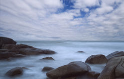 Seascape with long exposure with blue sky Royalty Free Stock Photography