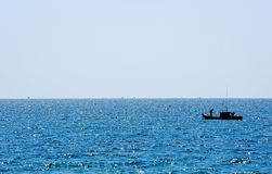 Seascape. A long tail boat Royalty Free Stock Image