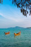 Seascape with longtail boats in Phuket Stock Photo