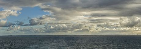 Seascape with a lot of big clouds Stock Photography
