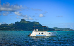Seascape in Mahebourg, Mauritius. Mahebourg, Mauritius - Jan 3, 2017. A tourist boat on the sea in Mahebourg, Mauritius. Mauritius, an Indian Ocean island nation Stock Images
